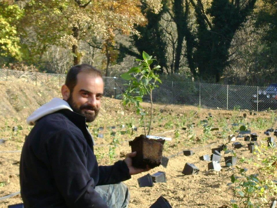 Nikos holding blueberry plant